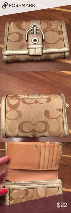 Reposhing coach wallet. Golden tones. I purchased this on Posh but it's too small for my taste.  Does have signs of wear in the patine of the leather,  some light marks on the fabric portions.  Inside of the zipped coin portion there are markings.  See pictures and if you need more feel free to ask! Coach Bags Wallets