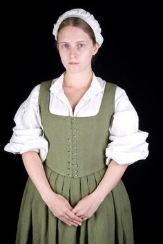 A very respectable peasant's market-day best. This bodice and skirt set is made from olive linen, spiral laced front and back for ease of adjustment.