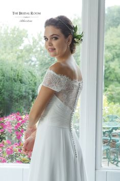 Create unforgettable memories in this off the shoulder A-line gown. The Alençon lace bodice with scalloped edging at the neckline is finished with a pleated waistline and a chiffon skirt.