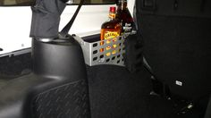 Just in time for the holidays, our Wrangler Unlimited rear fender organizer not only cleans up your Jeep® but it helps your cargo travel safely!