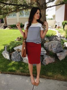 Shoulder panel, striped blouse with a red skirt
