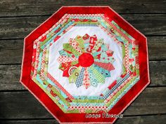 Dresden Plate Quilt-As-You-Go Table Mat from my friend LuAnn of Loose Threads.  This is fabulous!