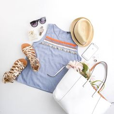 We paired this chambray sleeveless top with a minimal white tote bag, metallic gladiators, a straw hat, and black sunglasses for this flatlay. Find more at www.thmlclothing.com