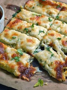 Low Carb Cauliflower Breadsticks with fresh herbs, garlic, and lots of ooey gooey cheese atop a cauliflower crust looks and tastes like cheesy bread! One of my favoite low carb recipes! Cauliflower Breadsticks, Cheesy Cauliflower, Cauliflower Crust, Breadsticks Recipe, Garlic Breadsticks, Califlower Garlic Bread, Cauliflower Recipes, Cauliflower Cheese Bread, Garlic Cheese