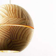 A #handturned and stained #plantation #pine pendant inspired by the #planet #saturn. By projecting light rings on its surrounding Saturn creates a galactical light experience. Pendant lamp by @ilanel #archiproducts #ilanel