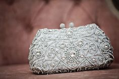A jeweled purse is a great way to add some bedazzle to your wedding gown – it's (no pun intended) so #clutch! #accessory #rhinestones