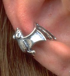 This solid sterling silver Bat Ear Cuff clings to the edge of your ear. It fits both right and left ears equally well.  From Etsy