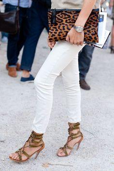 White denim, strappy sandals + leopard clutch
