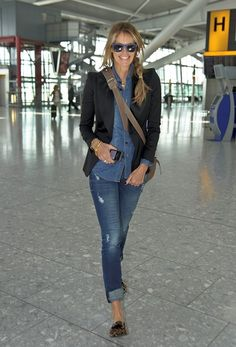 Dare: Elle Macpherson looks great wearing double denim as she made her way  through Heathrow Airport on Thursday