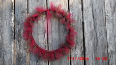 This is a barrel hoop and tulle fabric. It hangs on my barn door. 2015