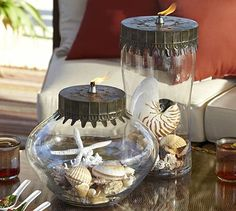 Oil lamps have a rich history that dates back for thousands of years. Ours are designed with a clear glass base that holds the oil and reflects the flickering flame. Place several around an outdoor setting for a warm, gentle light display.  Vivian Display Oil Lamp #potterybarn