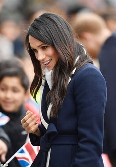 Meghan's face was animated as she moved along the crowds and greeted well-wishers in Birmingham today