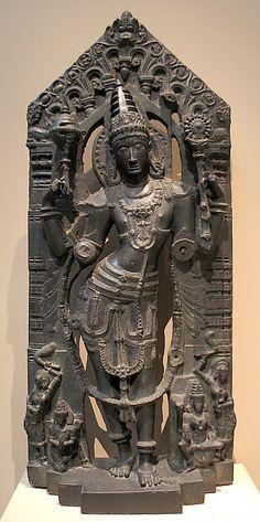 Lord Vishnu with Lakshmi, Garuda, & attendants. Black stone sculpture. Andhra Pradesh, India. Kakatiya period, 12th-13th century.