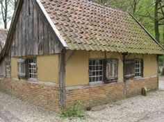 This is a light straw-clay building in the Open Air museum in the Netherlands. the museum is full of historic buildings that have been moved to location   My House of Earth
