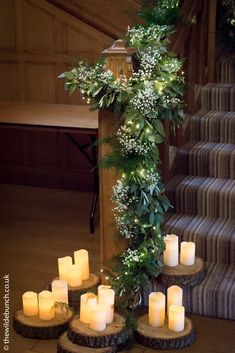 A stunning winter stair garland at Coombe Lodge by Bristol florists, The Wilde Bunch. Blue spruce and foliage with a 'frosting' of gypsophila and warming candles at the base. Wedding Staircase Decoration, Wedding Stairs, Garland Wedding, Wedding Flowers, Lodge Wedding, Wedding Venues, Wedding Ideas, Autumn Wedding, Christmas Wedding