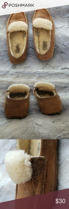 UGG Slippers Used UGG slippers. Right one has been repaired professionally after it tore, noted in pic 3. Bottoms have white paint on them. Offers welcome! UGG Shoes Slippers