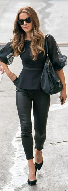 Who made Kate Beckinsale's sunglasses, peplum mesh top, suede black pumps, leather pants, and handbag?