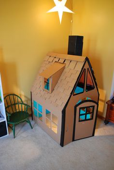 Playhouse made from cardboard. Love the detail, it even has tiles!