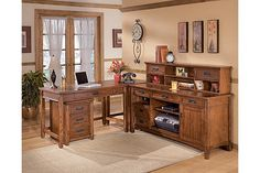 """The Cross Island 60"""" Credenza from Ashley Furniture HomeStore (AFHS.com). The richly detailed mission design of the """"Cross Island"""" home office collection captures the beauty of rich country style with a versatility that enhances any home environment."""