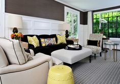 Fabulous combination of patterns and solids accented with high wainscoting and large windows. Stunning!