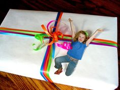 What child wouldn't love personalizing his or her friend's birthday gift with a photo tag. The look is unique and there's no guessing whom the gift is from.