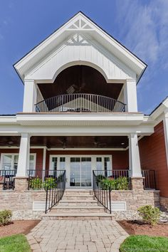 First and second floor porches in The Rangemoss, plan 1211. http://www.dongardner.com/house-plan/1211/the-rangemoss. #RearPorch #OutdoorLiving #Home