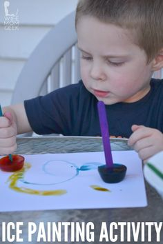 Painting with colored ice - a fun summer kids activity!