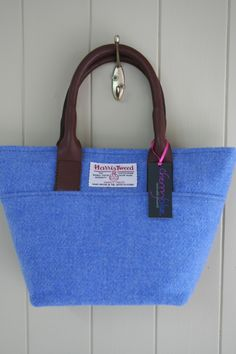 Small but perfectly formed with a simple and stylish shape, ideal for carrying the essentials for that evening out or lunch with friends. This beauty is made from a beautiful sky blue and has been lined with a pretty floral of pink, lilac and blue. How To Make Brown, Small Tote Bags, Harris Tweed, Lilac, Pink, Leather Handle, Brown Leather, Stylish, Blue