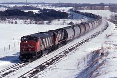 A pair of differing MLW styles  Westbound at Newtonville Ontario on the two main track between Montreal and Toronto.