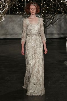 love the draped sleeves on this shimmering wedding dress by Jenny Packham