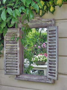 On a garden wall or fence place a mirror inside a shuttered window frame to give…