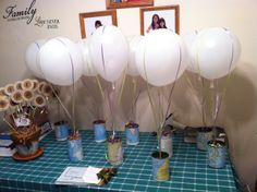 Retirement party theme: travel the world centerpieces for tables : can; ribbon; balloon foam map used for cans :)