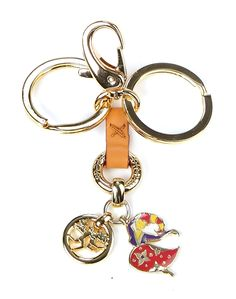 Key holders with pendants - golden metal and leather $78.00