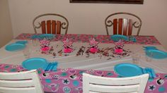 table for the party snacks cake icecream and pizza