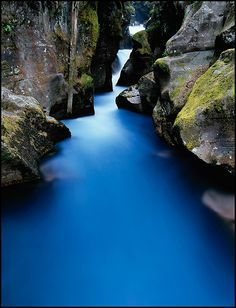 Avalanche Creek, blue colored water caused by glacial silt, Glacier National Park, Montana, July
