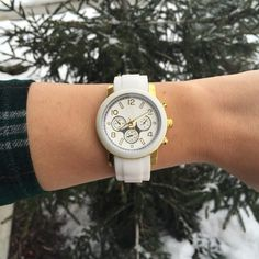 "White & Gold Watch White & Gold watch with a rubber wrist band and gold plated base. The metal is lead and nickel free. Hook and loop buckle. Watch face has a 1.5"" diameter. Adjustable up to approximately 8"". So cute! Also available in black. T&J Designs Accessories Watches"