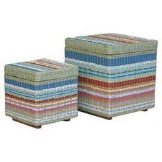 "Two striped storage ottomans made with hand-woven rattan. Product: Small and large storage ottomanConstruction Material: Natural rattan and wood Color: MultiFeatures:  Handwoven into a unique stripe patternTop opens with hinges on one side great for additional storage Dimensions: 20"" H x 18"" W x 18"" D (large)"