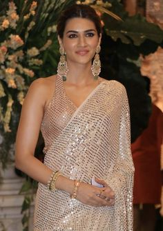 Kriti Sanon Sizzles In Manish Malhotra's Exquisite Saree As She Arrives For Ganesh Darshan At Ambani House - HungryBoo Saree Blouse Neck Designs, Fancy Blouse Designs, Blouse Patterns, Indian Bollywood Actress, Bollywood Fashion, Bollywood Saree, Indian Actresses, Beautiful Saree, Beautiful Indian Actress