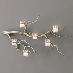 This is super cute... I'm pretty sure I could make this! Just the right tree branch, wire, hardware, spraypaint the whole thing once it's put together. Then add the candles and their holders? Yup, that'd do it!