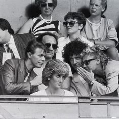 David Bowie chats with Brian May and Roger Taylor (Queen) whilst Princess Diana sit in the front row, Live Aid, 1985. - History