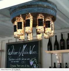 """DIY Wine barrell/wine bottle chandelier WOULD be beautiful for an outside bar or """"mans"""" cave"""
