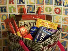 "Teacher's survival kit: instant coffee, pretzels, milk and dark chocolate, raisins, anti-acids, vitamin C, gum, ""the red pen!"""