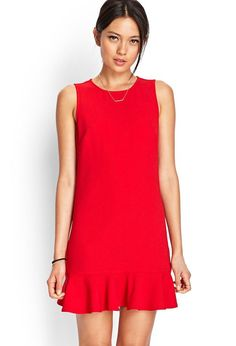 Sleeveless and sleek, this textured shift dress features a ruffled hem and invisible back zipper....