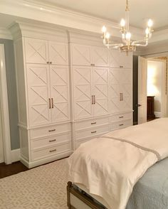 We built this for our client's Master Suite to replace a large free standing armoire. The TV is concealed behind pocket doors and I designed this piece to be shallower so it wouldn't impede the main traffic area. She now has more efficient storage than with her old armoire. Our client just told me she loves the clean look of her new bedroom and she hasn't even filled all of the shelves and drawers. I love to hear that--it makes my design heart so happy! • • • #amyvermillioninteriors…