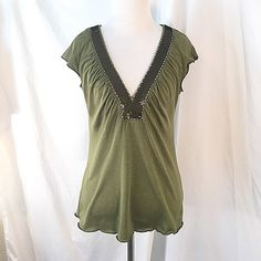 BCBG MaxAzria Olive Green Top Cute olive green and bronze sequined v-neck top. The top is a silk and cotton blend and has capped sleeves. BCBGMaxAzria Tops