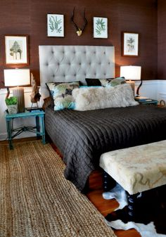 brown bedroom. Green & blue accents. That big white furry pillow is a must have!