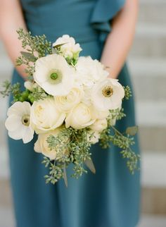 White whimsical bouquet..and oh ! the colour of that dress!!!
