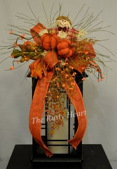 Fall Lantern Swag with Burlap Ribbon and by TheRustyHeart on Etsy (Decoracion Halloween Espantapajaros) Fall Lantern Centerpieces, Fall Lanterns, Christmas Lanterns, Lanterns Decor, Christmas Hanukkah, Christmas Ornament, Fall Swags, Fall Wreaths, Cage Deco