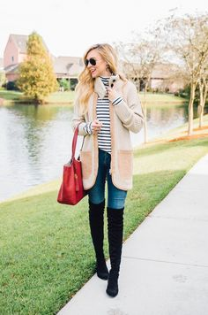 easy and chic fall layering ideas. White and black striped tee+skinny denim+black over the knie boots+beige and camel knitwear long cardigan+red handbag+aviator sunglasses. Fall Outfit 2016