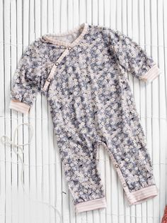 A criss cross neckline and snaps at the legs make this onesie easy to get on and off. Use this pattern for pajamas, or for the comfy one piece your baby will wear every day. This pattern is unisex, so why not add buttons or bows for a girlier version?